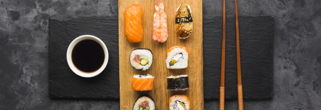 top-view-sushi-plating-slate-background